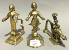 Three antique Indian brass Puja lamps, two of figural form,