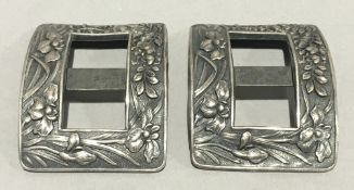 A pair of Chinese silver buckles