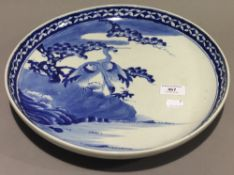 A Chinese blue and white charger decorated with two cranes