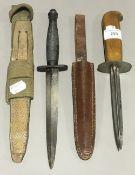 A Fairbairn-Sykes commando knife and canvas sheath;