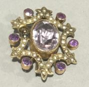 A Victorian 9 ct gold amethyst and seed pearl pendant/brooch