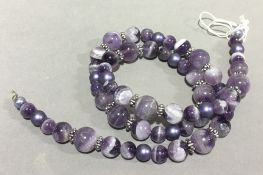 A Brazilian amethyst bead necklace