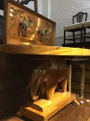 An Eastern hardwood elephant table and two pictures