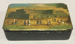 A Victorian papier mache snuff box decorated with The Crystal Palace