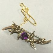 A 9 ct gold amethyst and seed pearl double bird brooch
