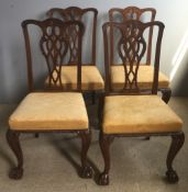 A set of four George II revival mahogany dining chairs