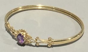 A 9 ct gold and amethyst bracelet