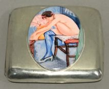 A silver cigarette case depicting a nude