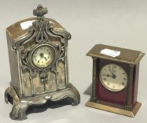 An Art Nouveau mantel clock and another