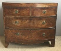 A small Georgian mahogany bow front chest of drawers