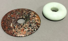 A Chinese jade roundel and a small bi disc