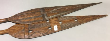 Two tribal paddles
