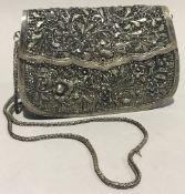 An Eastern unmarked silver filigree purse