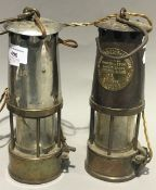 Two miners' lamps,