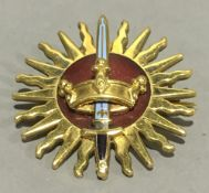 An enamel decorated 9 ct gold brooch (10.