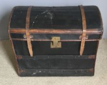 A French au depart leather bound trunk with fitter interior and old paper label
