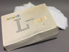 A Liberty box containing a quantity of net curtains