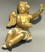 A 19th century carved gilt wood model of a cherub