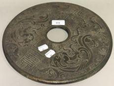 A Chinese carved bi disc