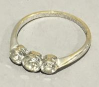 A 18 ct white gold three stone diamond ring