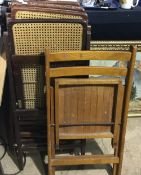 A quantity of folding caned chairs,