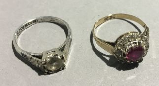 A gold ring, marks rubbed, together with another,
