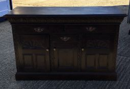A Victorian carved oak sideboard