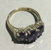 A 9 ct gold three stone ring (4 grammes all in)