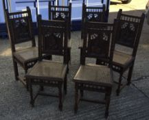 A set of six carved oak dining chairs