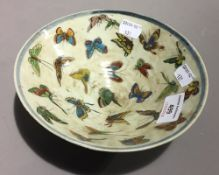 A Chinese porcelain bowl decorated with butterflies
