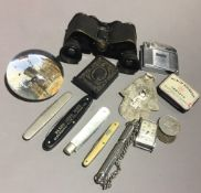 A quantity of miscellaneous items, including opera glasses, vesta, coins, etc.