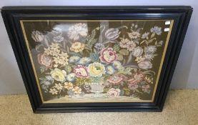 A framed tapestry panel