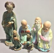A collection of small Chinese porcelain figures