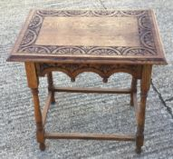 A Victorian carved oak side table