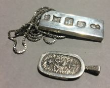 A fully hallmarked silver ingot on silver chain,