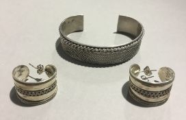 A silver bracelet and earring set
