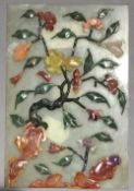 A Chinese jade and hardstone plaque