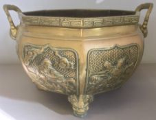 A Chinese cast metal twin handled jardiniere, of octagonal section, cast with figural vignettes,