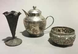 Three Eastern white metal items, a teapot,