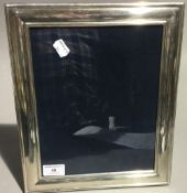 A hallmarked silver photo frame