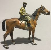 An early 20th century cold painted bronze figure of a horse and jockey, probably Austrian. 11.