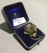 A tutti frutti flowering basket brooch