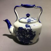 A large Victorian blue and white porcelain teapot