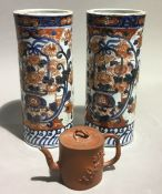 A pair of 19th century Imari sleeve vases and a Yixing teapot