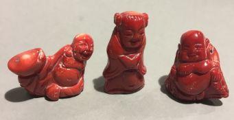 Three coral Buddhas