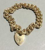 An Edwardian 15 ct rose gold bracelet, with heart shaped locket (approximately 28.