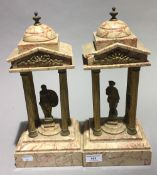 A pair of Victorian figurally mounted gilt metal and marble garnitures