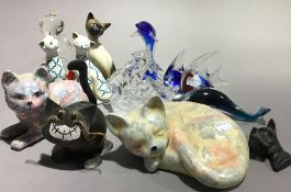A quantity of glass and ceramic cats and other animals