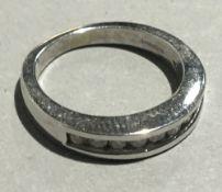A 9 ct white gold diamond half eternity ring