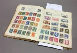 A stamp album and contents,